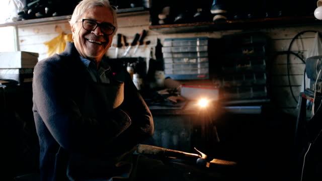 Cobbler in his workshop
