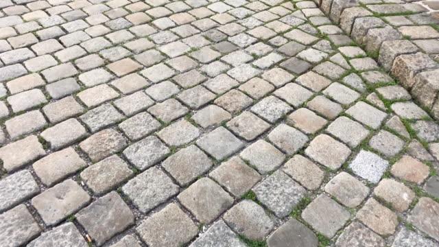 cobblestone old street - cobblestone stock videos and b-roll footage