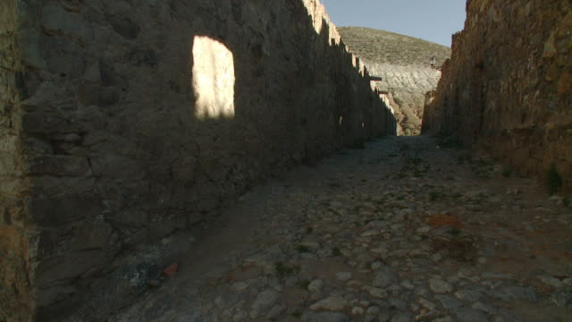 ws cobblestone road passing through stone wall / real de catorce, san luis potosi, mexico - stone wall stock videos and b-roll footage