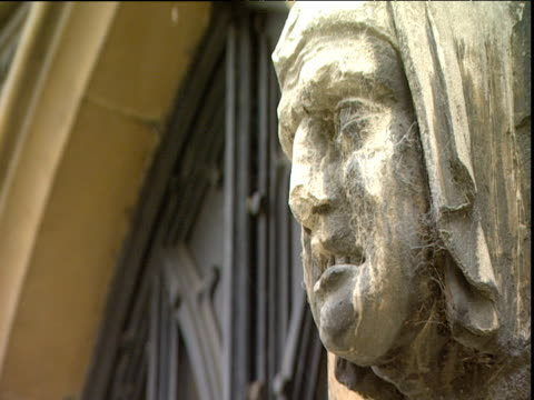 cobwebs on carving of face with nose partially broken off on side of st mary's church putney - arachnid stock videos and b-roll footage