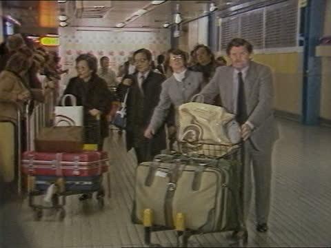london: heathrow: int passengers towards wheeling luggage thru terminal tx /naf - archival stock videos & royalty-free footage