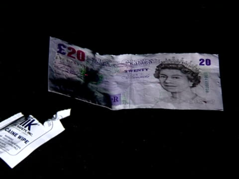cocaine testing wipes used to swab a twenty pound note - testing kit stock videos & royalty-free footage