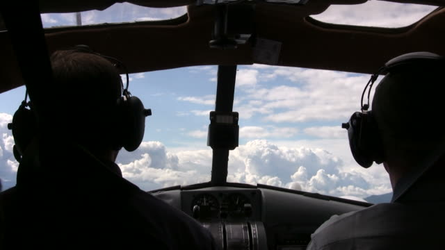cockpit view of seaplane flying into clouds - pilot bildbanksvideor och videomaterial från bakom kulisserna