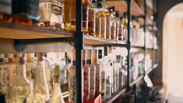 cocktail bar - shelf stock videos & royalty-free footage