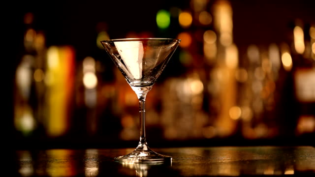 cocktail on a bar counter - martini stock videos & royalty-free footage