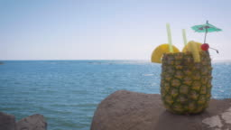Cocktail Served in a Fresh Pineapple at a Oceanfront Resort in 4k
