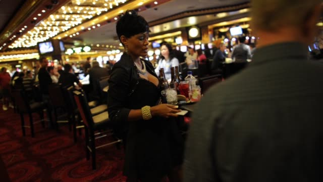cocktail waitress delivers drinks at the mgm resorts international casino in las vegas nevada cocktail waitress at mgm resorts at mgm resorts... - waitress stock videos & royalty-free footage
