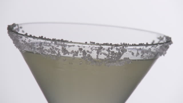 cocktail with salt rim, pull focus - margaritas stock videos and b-roll footage