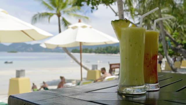 cocktails glass on table with beach and sea view - tropical drink stock videos & royalty-free footage