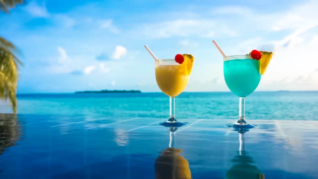cocktails standing in the pool near the sea - standing water stock videos & royalty-free footage