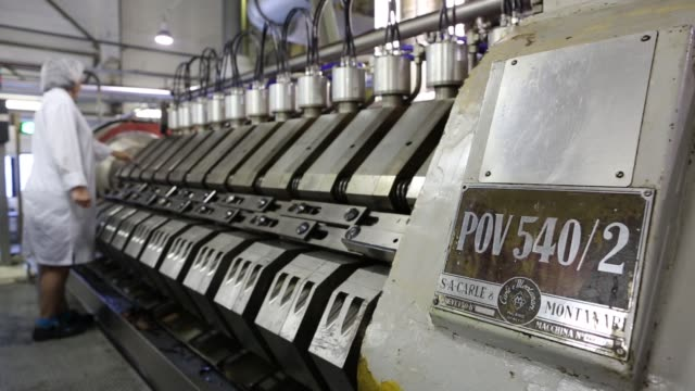 Cocoa beans fall from a chute during the early stages of processing at the Rossiya chocolate factory operated by Nestle SA in Samara Russia on...