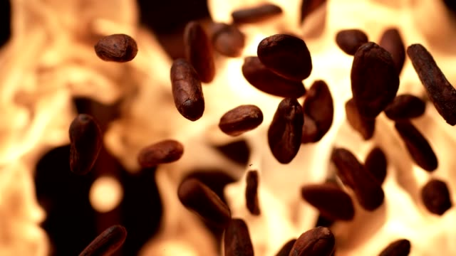 Cocoa beans roasting on flames. Super slow motion