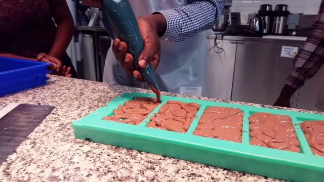 Cocoa farmers from Ghana have been given a glimpse of how their product turns into chocolate in the UK as part of a scheme to boost the...