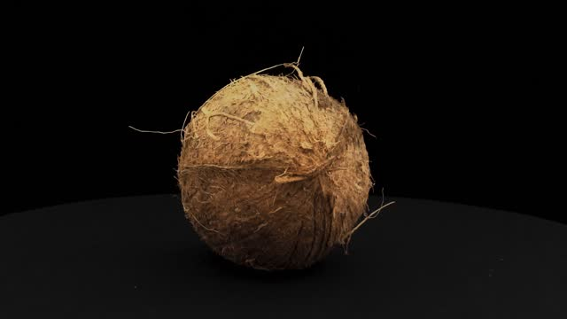 coconut  360 of spin around themselves on a black background and ground - coconut stock videos & royalty-free footage