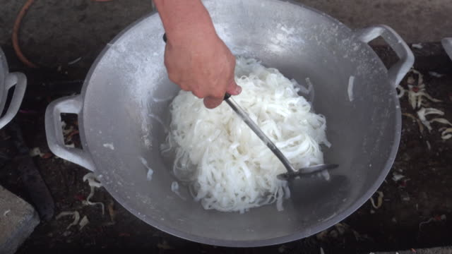 coconut fried in pan with sugar iii 4k - serving utensil stock videos and b-roll footage