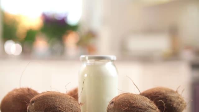 coconut oil in jar - coconut stock videos & royalty-free footage