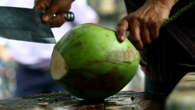 Coconut opening breaking by machete