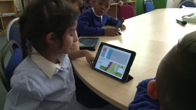 coding has become compulsory for children as young as five in schools across the uk - coding stock videos & royalty-free footage