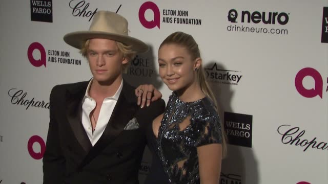 cody simpson and gigi hadid at the 23rd annual elton john aids foundation academy awards viewing party sponsored by chopard, neuro drinks and wells... - ジジ・ハディッド点の映像素材/bロール