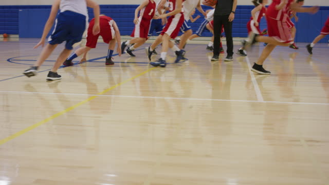 coed basketball team running lines in a gym - basketball sport stock videos & royalty-free footage