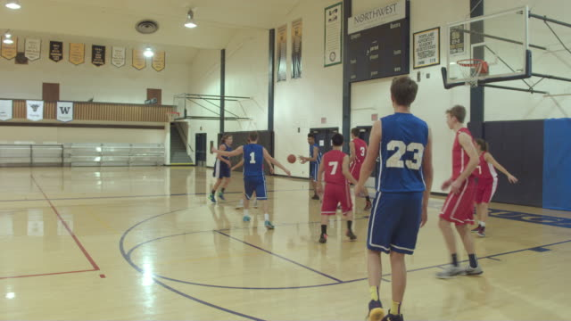 co-ed high school basketball players competing in a game - basketball sport stock videos and b-roll footage