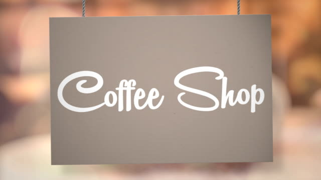 coffe shop sign hanging from ropes. luma matte included so you can put your own background. - matte board stock videos & royalty-free footage