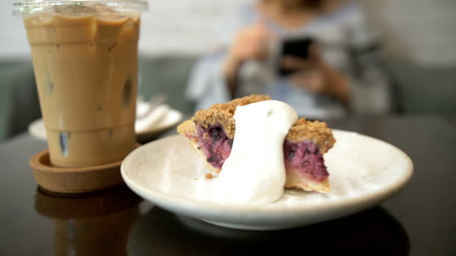 cu : coffee and blueberry cheesecake in a cafe - cafe macchiato stock videos and b-roll footage
