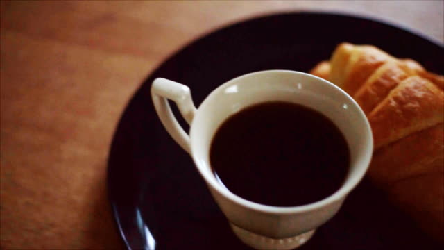 coffee and croissant on wood table - croissant stock videos & royalty-free footage