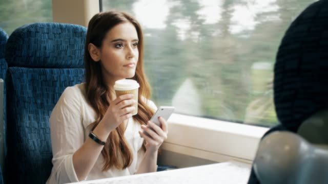 Coffee and smartphone on a train. Loopable cinemagraph.