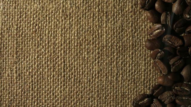 コーヒーの背景 - 荒い麻布点の映像素材/bロール