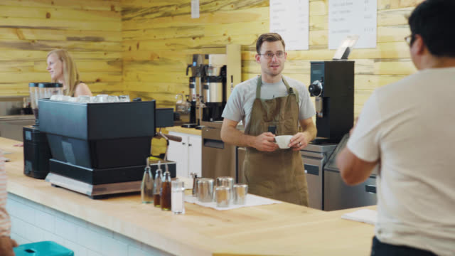 coffee bar owner serves patrons - cafe stock videos & royalty-free footage
