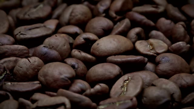 coffee bean background - roasted coffee bean stock videos & royalty-free footage