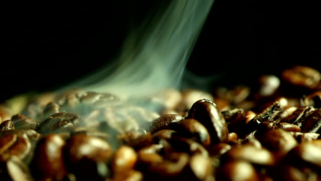 coffee beans and steam - bean stock videos & royalty-free footage