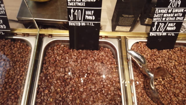 coffee beans are prepared for sale at starbucks reserve roastery during a media preview on november 12, 2019 in chicago, illinois. with 35,000 square... - roasted coffee bean stock videos & royalty-free footage