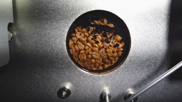 coffee beans are seen in the roaster at the chosen bean specialty coffee company on april 24 2019 in oakland park florida the price of coffee beans... - ugnsstekt bildbanksvideor och videomaterial från bakom kulisserna