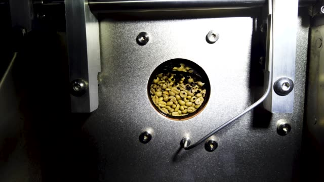coffee beans are seen in the roaster at the chosen bean specialty coffee company on april 24 2019 in oakland park florida the price of coffee beans... - コーヒー豆点の映像素材/bロール