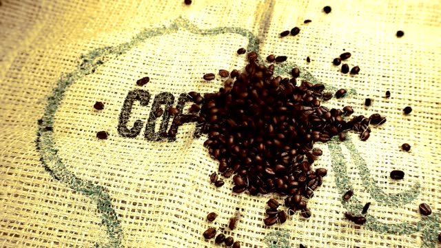 coffee beans are spilled on a jute bag - typescript stock videos & royalty-free footage