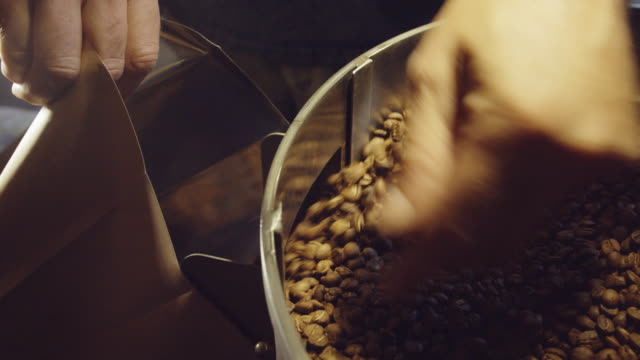 coffee beans being bagged - paper bag stock videos & royalty-free footage