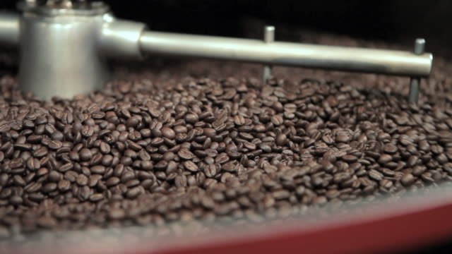 Coffee beans being ground in coffee grinder