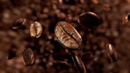 Coffee beans explosion in super slow motion 4K