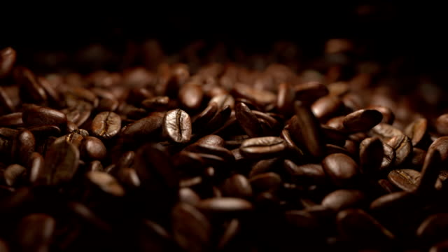 coffee beans falling commercial in super slow motion - bean stock videos & royalty-free footage