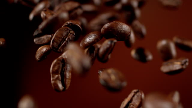 coffee beans falling down - roasted coffee bean stock videos & royalty-free footage