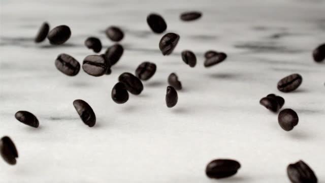 CU SLO MO Coffee beans falling on floor / San Francisco, California, USA
