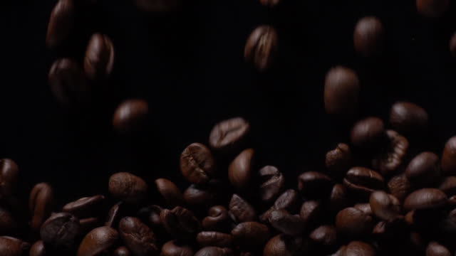 coffee beans filling full on black background - freshness stock videos & royalty-free footage