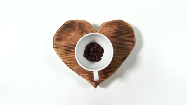coffee beans in a cup, debica, poland - roasted coffee bean stock videos & royalty-free footage