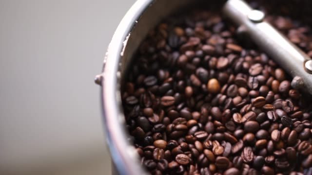 coffee beans in coffee roaster - hsyncoban stock videos and b-roll footage