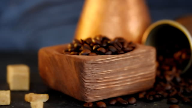 Coffee beans in copper and wood