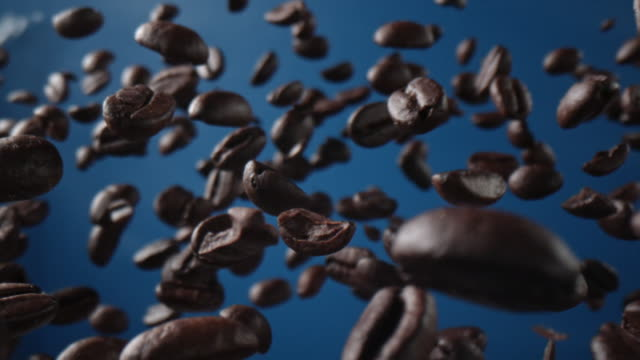 coffee beans in the airon blue background - zero gravity stock videos & royalty-free footage