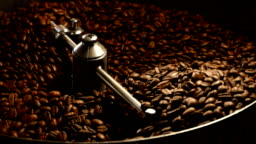 Coffee beans in the grinder. Fresh Coffee In coffee professional machine. Aroma, background.