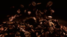 Coffee beans jumping in super slow motion 4K